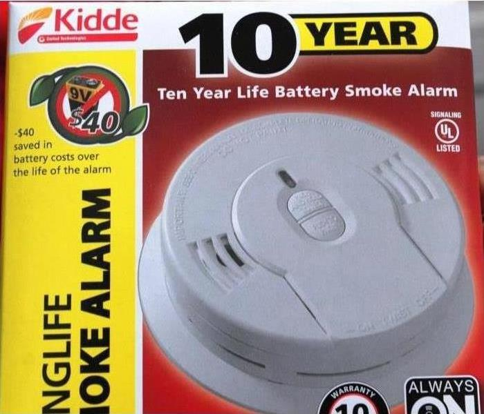 The Kidde smoke alarms installed by the American Red Cross has a ten year life battery.